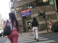 ass in pink jeans walking on the street