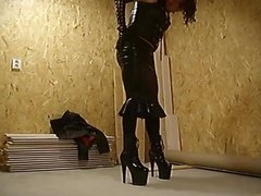 Tight latex dress and sky high boots