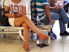 candid girl sexy crossed legs, feets in mini skirt