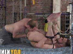 Tied up submissive guy endures whipping and ass fucking