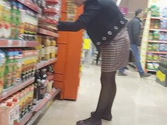Milf shopper in shiny black pantyhose with flats