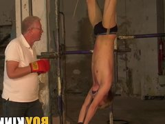 Young homosexual guy tied up and punished by dominant geezer