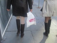 Two womens  in boots and a classy sexy leather coat!