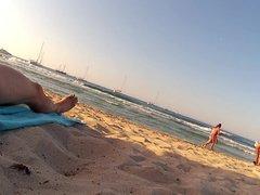 Women watching nudist man at the beach