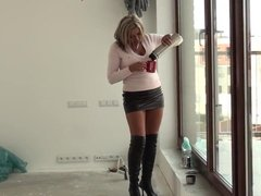 Milf in leather boots and leather skirt