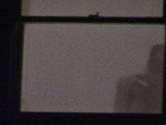 Undressing by the window Milf neighbour voyeur 6