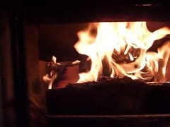 Burning wifes brown buckle shoe in the fireplace