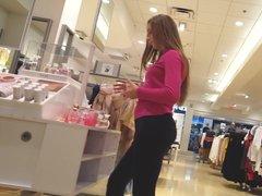 Candid voyeur cute teen in legging shopping with mom
