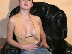 Cute girl stripping and playing with her pussy