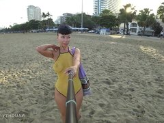 One piece mesh transparent swimsuit in public beach