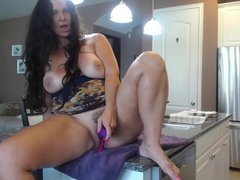 MOM WITH NICE BIG ASS TOYS HER PUSSY IN THE KITCHEN