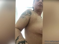 Milf playing with her tittis and pussy while in the shower.