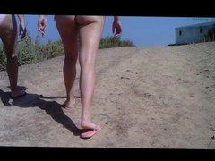 Candid brunette ass in thong bikini on the beach