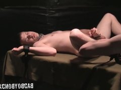 Captured boy strapped to table is spanked and made to cum