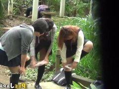 Teen asians pee outdoors and get spied on
