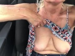 Showing tits in parking lot