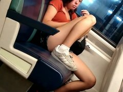 Cute young skinny girl nice legs on the train