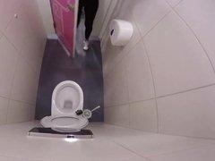 Woman pees hard in restaurant toilet
