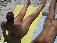 Horny Milf Getting Fingered by hubby at nudist beach spycam
