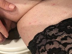 Sissy in heels with pierced tiny sissy clit on toilet 2