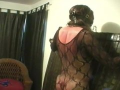 Black Domme Whips Ballgagged male Slave In Body Suit