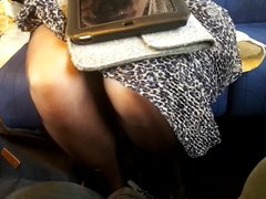 Girl in pantyhose and sneakers on the train