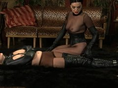 Two ladies play in leather and ballet & high heels